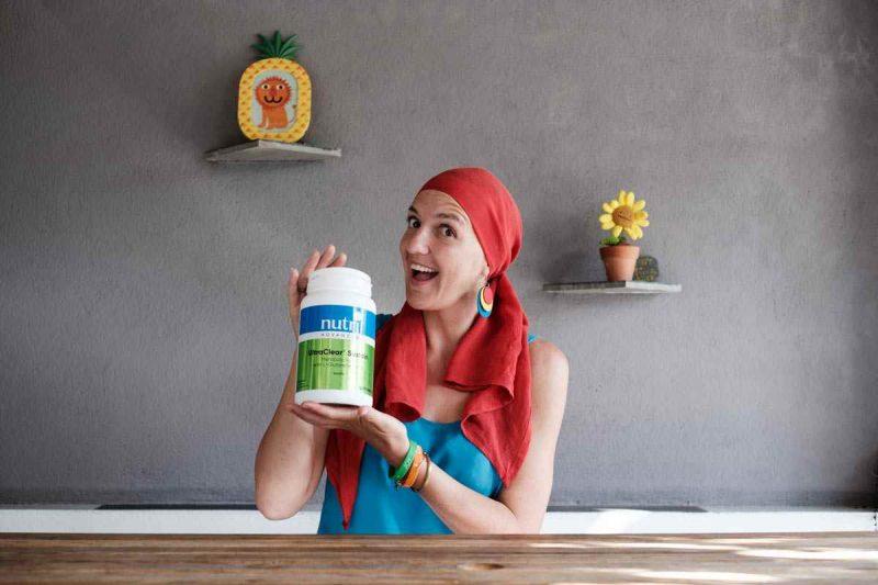 Lady Alopecia holding protein powder