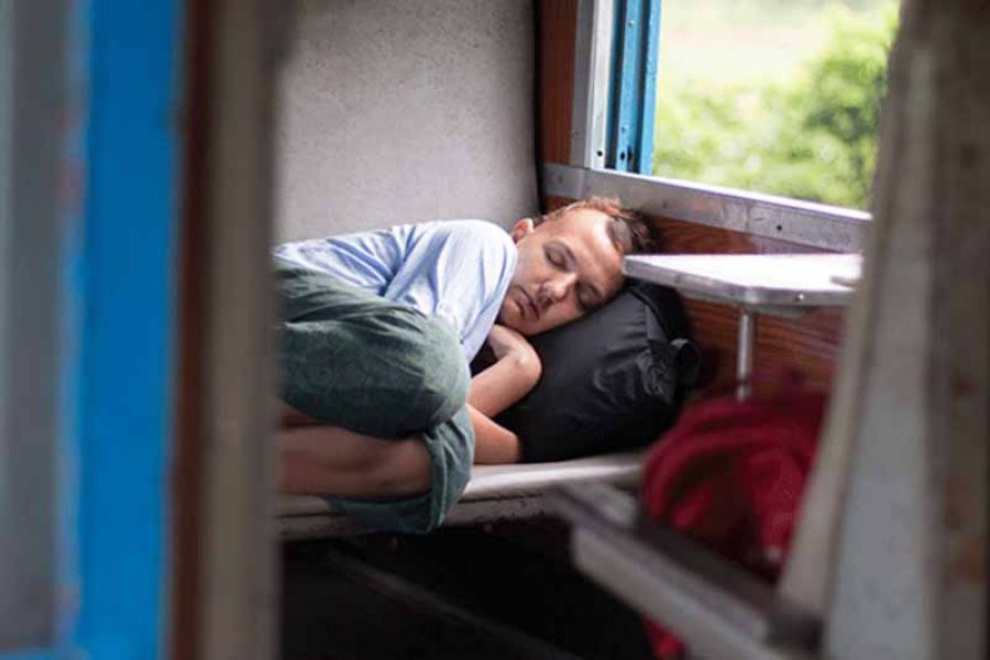 Emma asleep on train