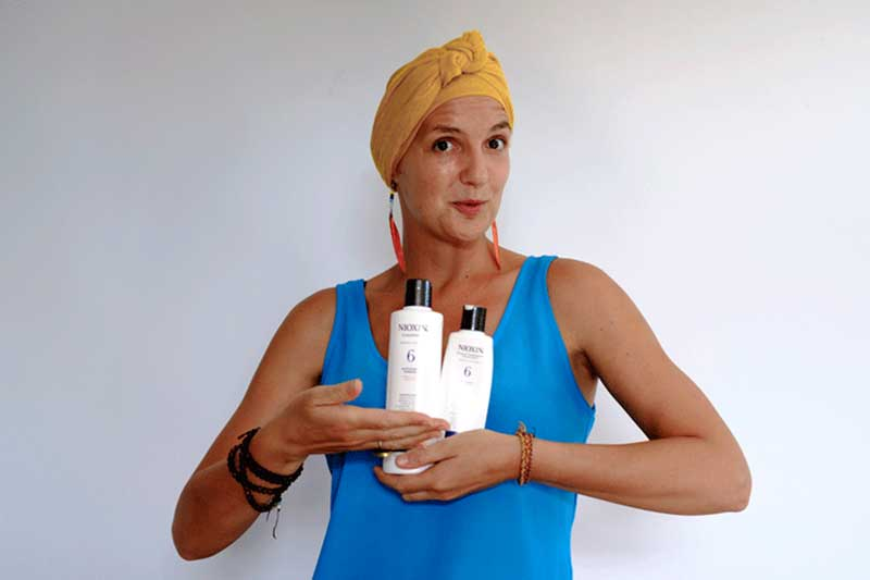 Lady Alopecia with Nioxin bottles