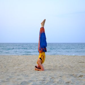 Lady Alopecia in a headstand