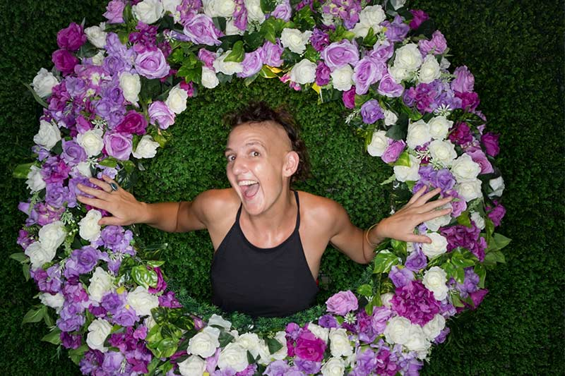 Me bursting through a wreath of flowers!