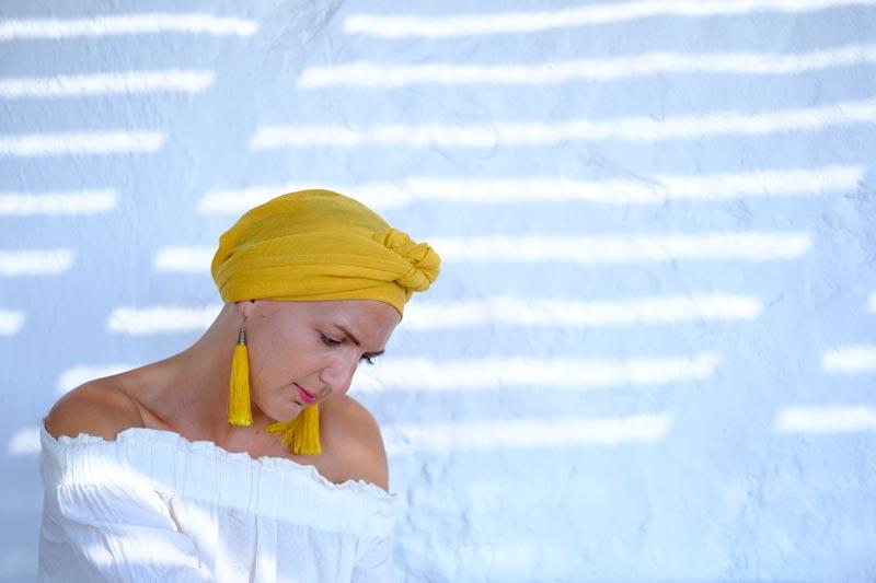 Emma in yellow headwrap